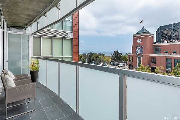 Photo #3 Expansive slate and glass terrace offering serene outdoor living, with distinctive San Francisco Bay and Giants AT&T Park views.