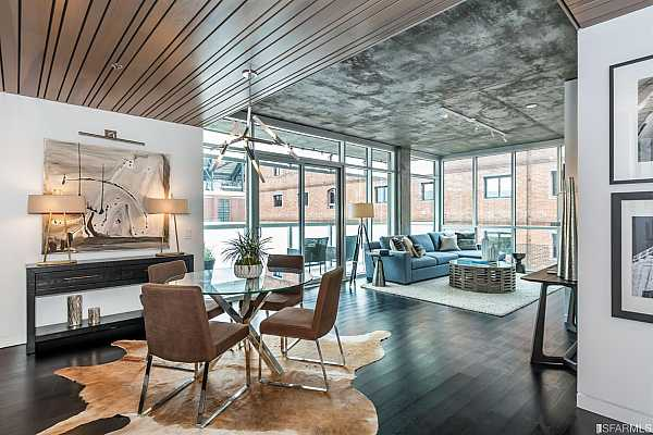 Photo #1 Impressive city residence featuring 2 bedrooms, 2.5 bathrooms, incredible modern finishes and design with dramatic exposed polished concrete, floor to ceiling glass, and custom wood plank feature walls.
