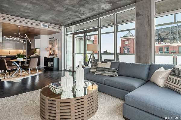 Photo #2 Sophisticated living room flooded with natural light, dramatic floor to ceiling windows, spacious walk out terrace with big views, rich Smith & Fong bamboo floors, gas fireplace, and media entertainment system.