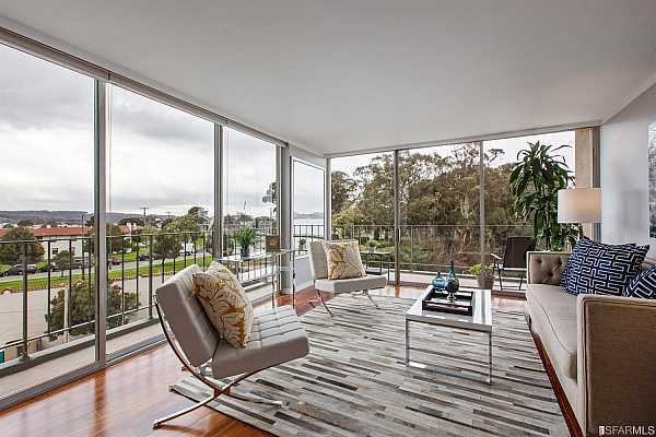 Photo #6 Living space showcasing views of the Golden Gate Bridge, Ft. Mason, the Palace of Fine Arts and the Marina