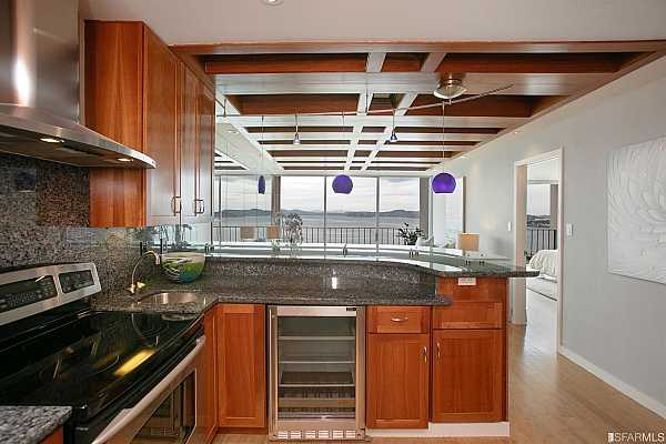 Photo #11 All Stainless appliances including two wine coolers