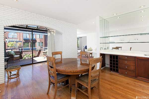 Photo #6 Generously sized dining room with wet bar opens to the view terrace and living room.