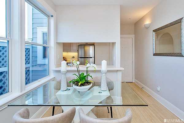 Photo #12 Open plan living/dining with large, bright view windows looking north, wood-burning fireplace and walk out private view terrace