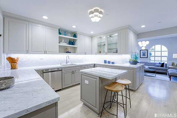 Photo #5 Large gourmet kitchen with plentiful counter and storage space.