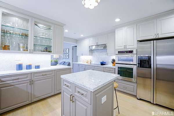 Photo #6 The kitchen impresses with Carrera marble countertops and stainless steel appliances.