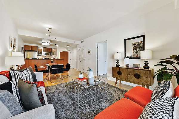 Photo #6 Enjoy entertaining friends in the open dining and living area that flows nicely to the spacious, chef's kitchen with stainless steel appliances, granite counters, ample Studio Becker custom cabinetry and breakfast bar.