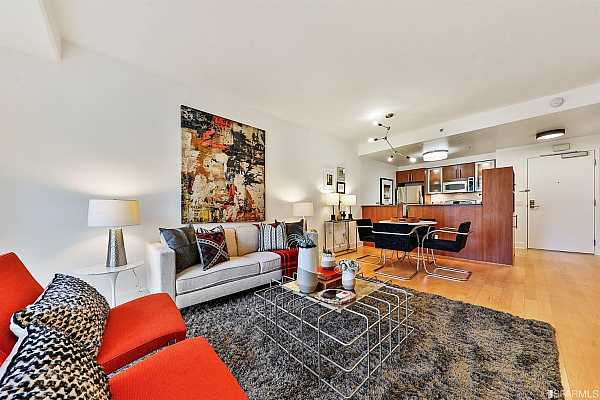 Photo #7 Enjoy entertaining friends in the open dining and living area that flows nicely to the spacious, chef's kitchen with stainless steel appliances, granite counters, ample Studio Becker custom cabinetry and breakfast bar.