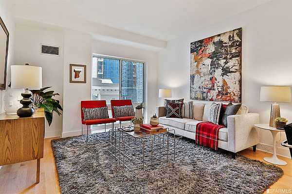 Photo #1 Welcome to 50 Lansing #311! This light-filled 1 bedroom, 1.5 bath condo is situated on a quiet tree-lined street on Rincon Hill. Walk to work and everything you need and then relax at home in your fabulous urban retreat!  This modern home boasts central heat and air conditioning plus in-unit laundry.