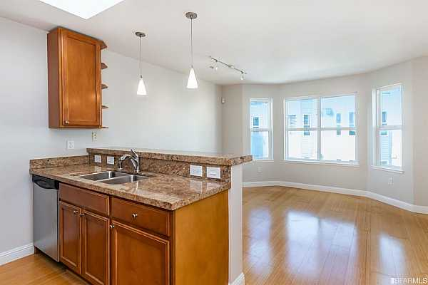 Photo #6 Bamboo floors throughout living/dining great room and kitchen