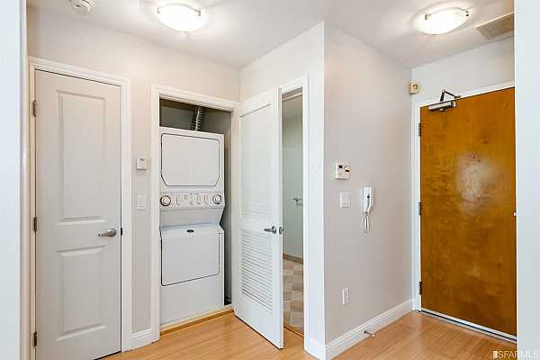 Photo #12 In-unit washer/dryer is conveniently tucked away in a closet between the bedroom and bath