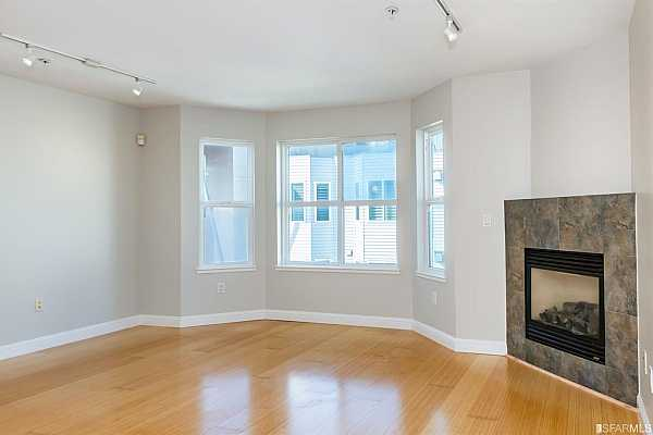 Photo #9 Bamboo floors throughout living/dining great room and kitchen
