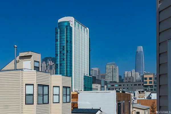 Photo #11 The living/dining great room and bedroom let you enjoy this view of downtown San Francisco including Salesforce Tower.