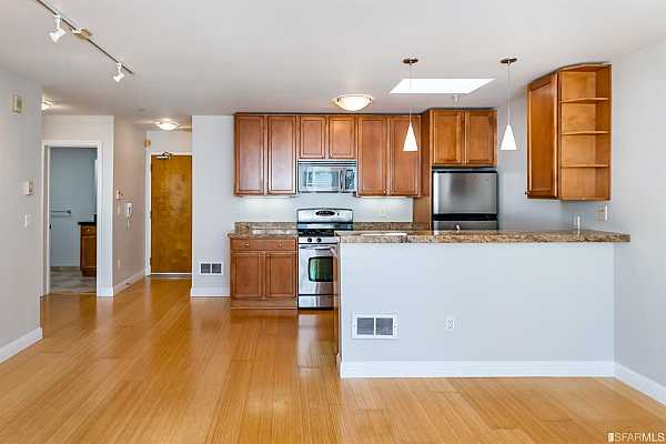 Photo #8 Kitchen with granite counters, breakfast bar and stainless steel gas range, microwave, dishwasher and refrigerator