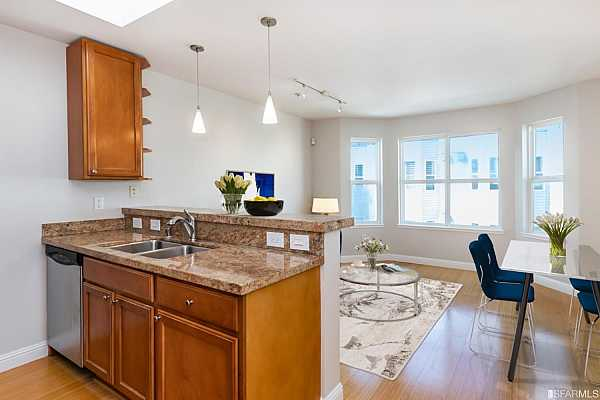 Photo #2 Bamboo floors throughout living/dining great room and kitchen.  This image shown with virtual staging.