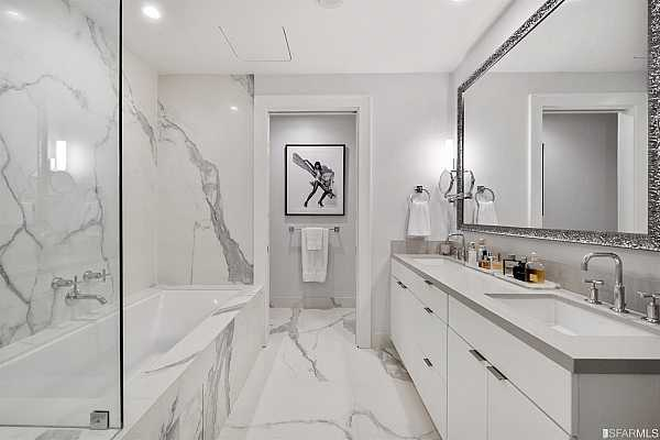 Photo #12 ...finished in Caesarstone and appointed with George Kovacs sconces, Kohler Purist fixtures, Decolav rectangular sinks, Emtek towel bars, Smoke crystal door knobs, an Arquati framed mirror and soft-close cabinets & drawers.
