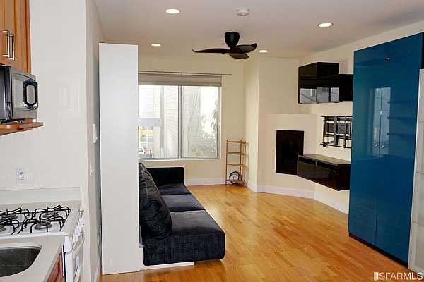 Photo #2 Enter Unit #301.  The nice sized windows let in ample light.  The bathroom is to your right.  The ceiling fan is a nice addition!