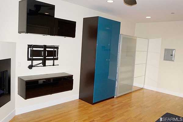 Photo #6 You have storage, a mount for your TV, and an attractive gas, in-wall heating unit.