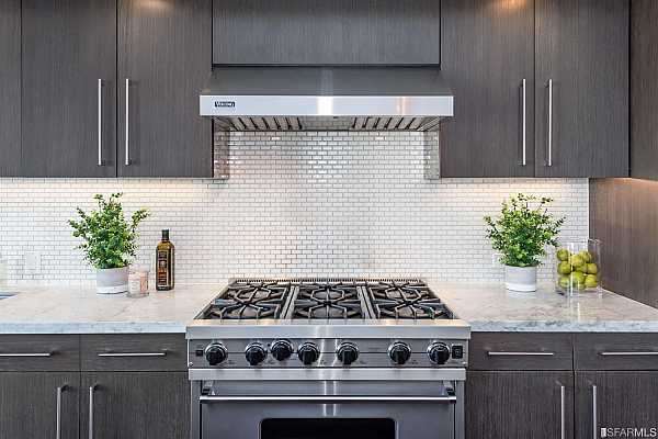 """Photo #7 Top-of-the-line stainless steel appliances include gas Viking stove and hood, perfect """"chef"""