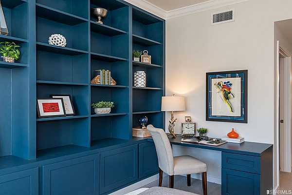 Photo #12 Built-in bookshelves and desk make this the perfect at home office space as well.