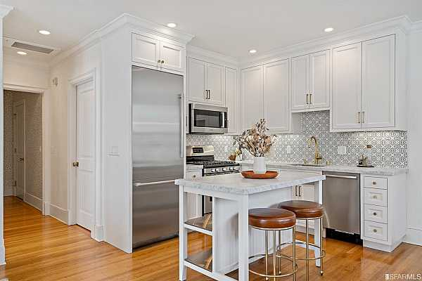 Photo #11 Kitchen has full suite of Bosch stainless steel appliances.