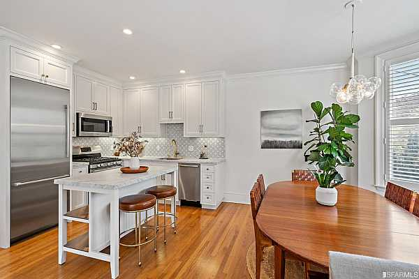 Photo #12 Kitchen island is perfect as breakfast bar or extension of kitchen prep space, and flows seamlessly with dining area.