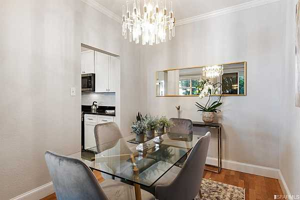 Photo #11 Dining area just off the kitchen with stunning lighting!
