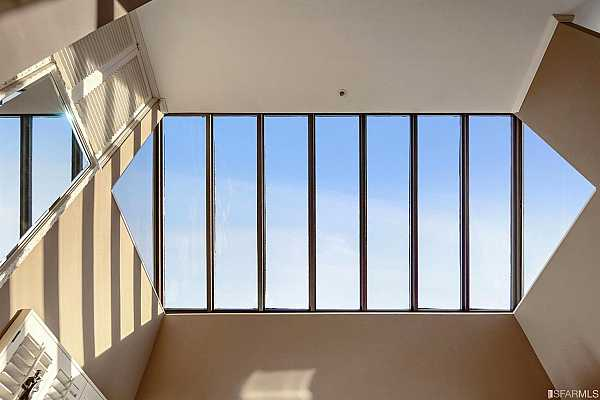 Photo #7 Massive skylight above living area dominates the character of this refined home.