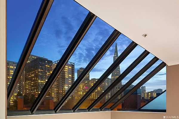 Photo #9 Skylight over living room showcases enchanting views of the Transamerica Pyramid and downtown skyline