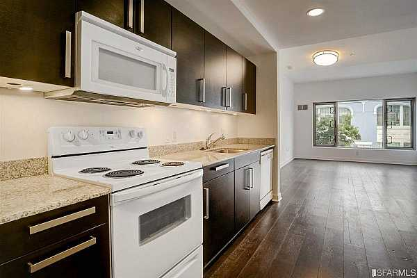 Photo #9 The kitchen area includes refrigerator, dishwasher, garbage disposal, microwave, and electric range