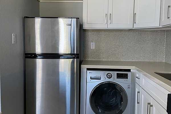 Photo #2 Kitchen: Refrigerator and Clothes washer/dryer