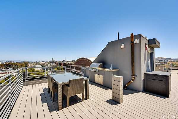 Photo #10 Shared roof deck with BBQ