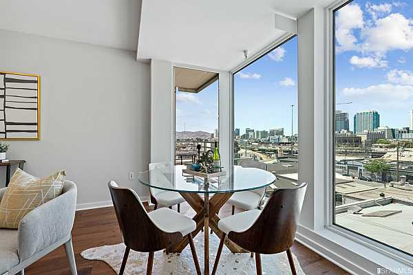 Photo #7 Large open living/ dining area with floor to ceiling windows with San Francisco City and Twin Peaks views, gorgeous new walnut wide plank floors and walk-out balcony