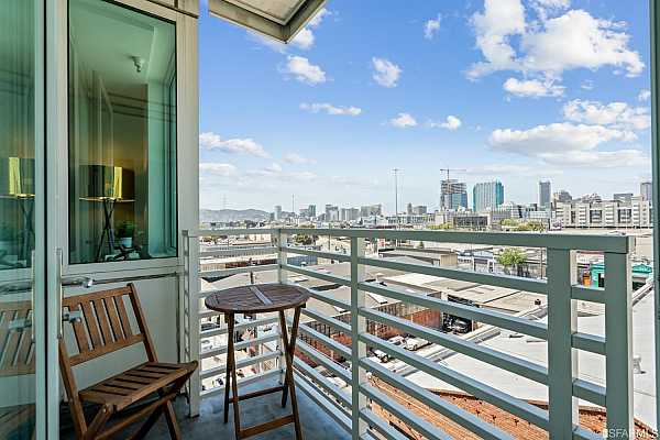 Photo #8 Large open living/ dining area with floor to ceiling windows with San Francisco City and Twin Peaks views, gorgeous new walnut wide plank floors and walk-out balcony