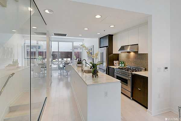 Photo #1 Spacious patio off main level affords ultimate indoor/outdoor living.