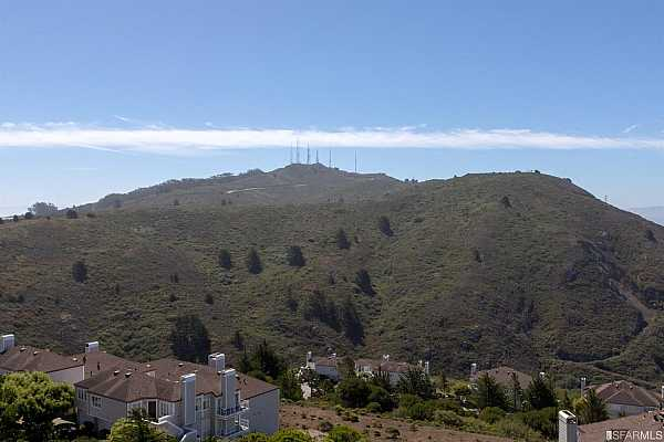 Photo #2 View from the deck and Living room of the San Bruno Mountain Park. Miles of trails to hike.