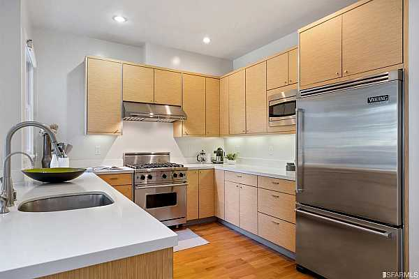 Photo #9 Superbly laid out working kitchen accented with a suite of Viking stainless steal appliances.