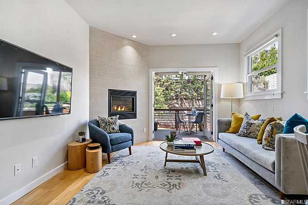 Photo #1 Living room flows seamlessly through french doors to secluded private deck.