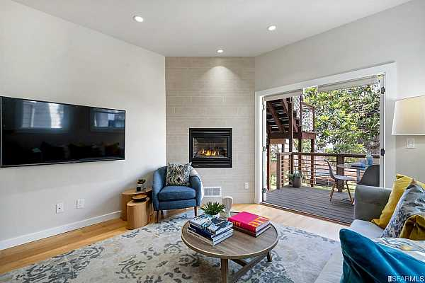 Photo #6 Enjoy the warm & cozy gas fireplace in the living room year round.