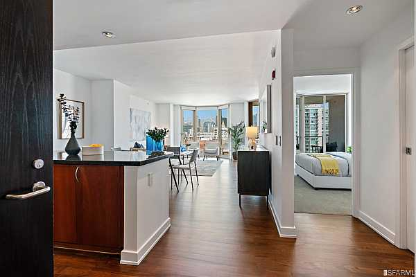 Photo #3 Large open living/dining area with floor to ceiling windows