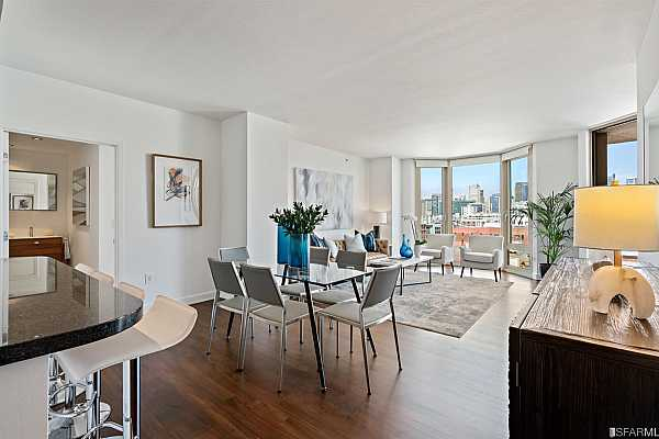 Photo #2 Large open living/dining area with floor to ceiling windows