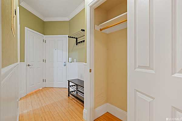 Photo #3 The spacious entry way leads to an eat-in kitchen, the bathroom and the living area.
