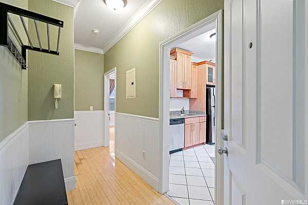 Photo #2 The spacious entry way leads to an eat-in kitchen, the bathroom and the living area.