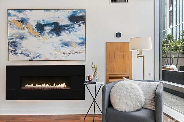 Photo #5 Custom upgrades include: a liner gas fireplace, upgraded thermostats and wood details.