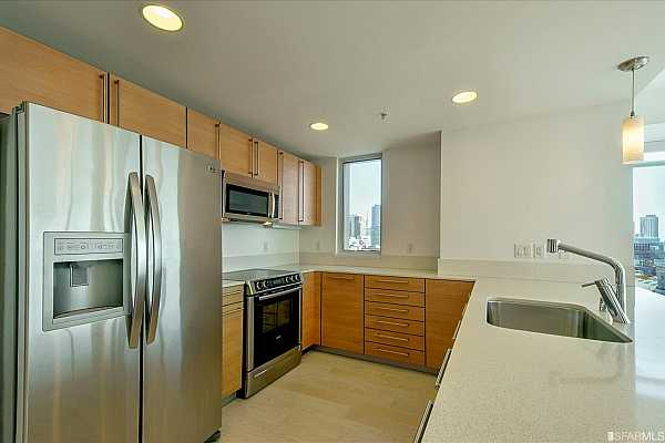 Photo #7 Stainless appliances, an abundance of counter space and cabinets plus a view! Let
