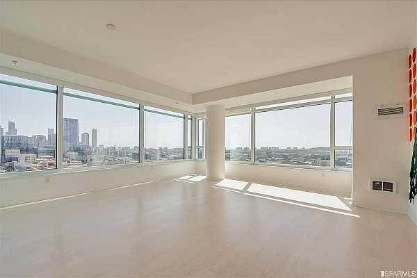 Photo #1 Living room with incredible views to the northwest, north, east and southeast!