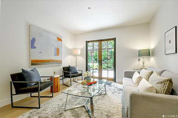 Photo #2 Living room has French door leading to your own private patio