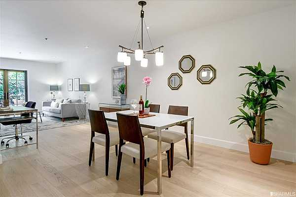 Photo #7 Newly renovated condo features an open floor plan with wide plank oak hardwood floors