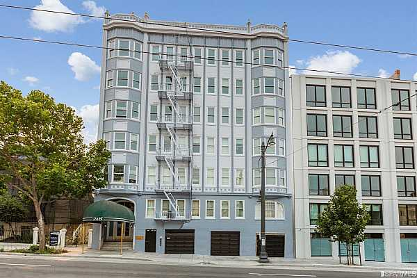 Photo #2 Newly waterproofed and painted front facade of 2415 Van Ness is surrounded by brand new luxury development Union House to the north and the historic landmark Russian Orthodox Church to the south.  New black awning will be installed this fall.