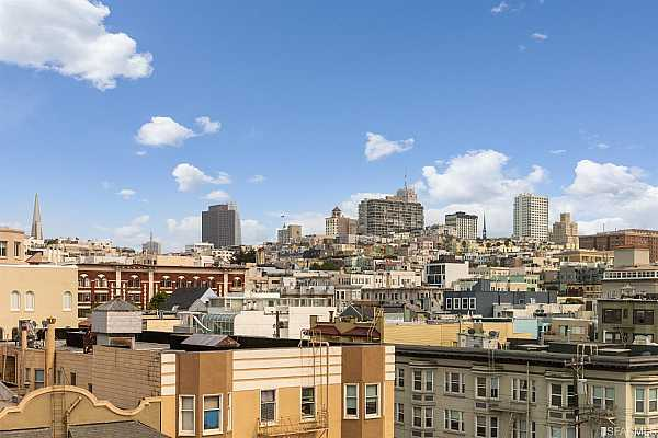 Photo #9 Nob Hill skyline views from the living room also feature the Transamerica Pyramid, B of A building, Salesforce Tower along with one of Grace Cathedral