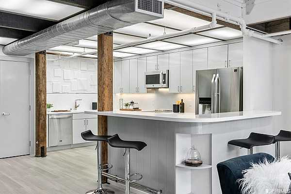 Photo #7 A brand new kitchen with an eat-at bar, state of the art finishes...